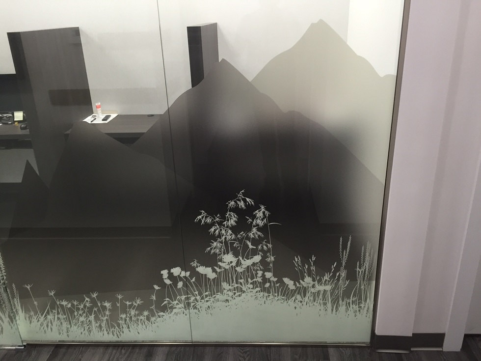 glass graphics installed to office glass wall